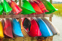 Colorful Kayaks Tied Up On Hil...