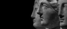 Marble Ancient Different Heads As Humankind In A Isolated Black Background, Streamer, Banner With Paste Space
