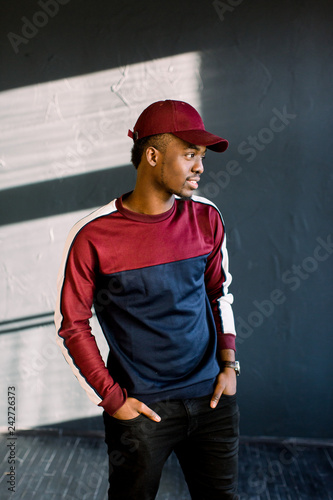African male fashion model dressed in in red baseball cap d05622be4a5