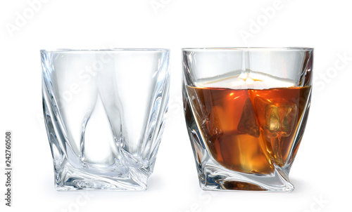 Empty and full whiskey glasses on white background Canvas Print