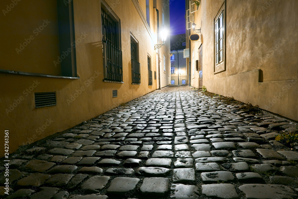 Fototapety, obrazy: Old narrow street in Prague, Mala Strana, late in the evening with street lights