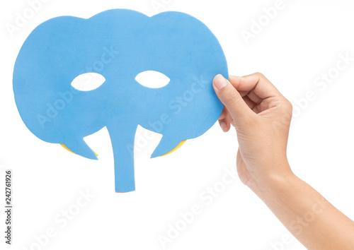 Fotografija  hand holding elephant carnival mask isolated on white background