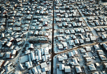 Aerial Of Rooftops Covered With Snow