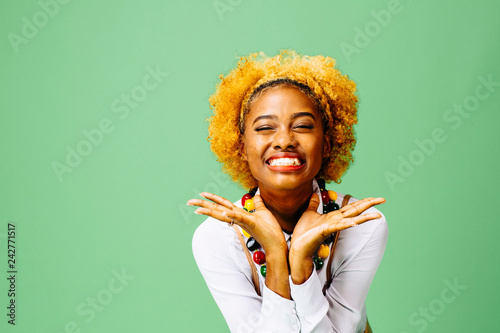 Fotografie, Obraz  Excited young woman, isolated on green studio background