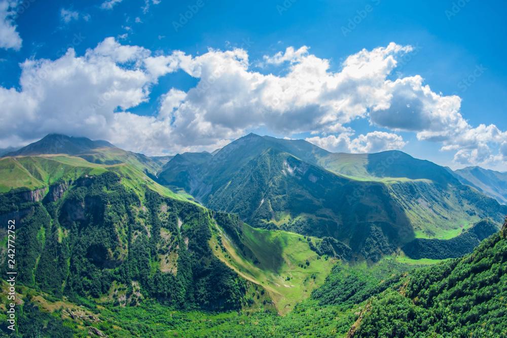 Fototapeta Beautiful summer mountain landscape. High green mountains on sunny day. Georgia Gudauri. - obraz na płótnie