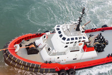 Red And White Tug Boat Mooring