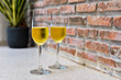 champagne glass with blurred brick background