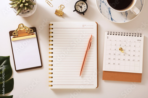 Flat lay desk with notebook and calendar, warm tone Slika na platnu