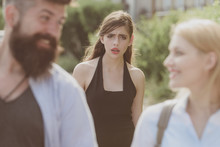 She Is The Jealous Type. Jealous Woman Look At Couple In Love On Street. Unhappy Girl Feeling Jealous. Romantic Couple Of Man And Woman Dating. Bearded Man Cheating His Girlfriend With Another Woman