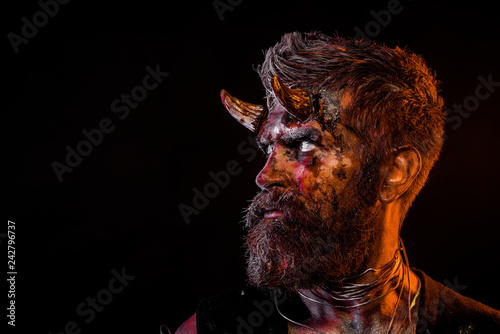 Fotografía  Halloween satan with beard, red blood, wounds on face profile