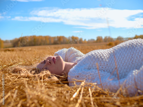 Fotografie, Obraz  Beautiful pregnant woman in a white woolen sweater