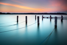 Lake At Sunset, Wooden Posts With Ropes
