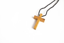 Simple Wooden Cross Necklace On ISolated White Background