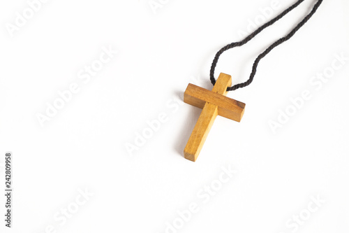 Fotografia  Simple Wooden Cross Necklace on iSolated White Background