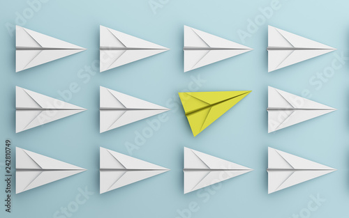 Fototapeta leadership or different concept with yellow and white paper airplane on blue background. Digital craft in education or travel concept. Mock up design. 3d abstract illustration obraz na płótnie