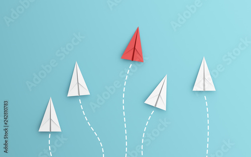 Fotografie, Obraz  leadership or different concept with red and white paper airplane path and route line on blue background
