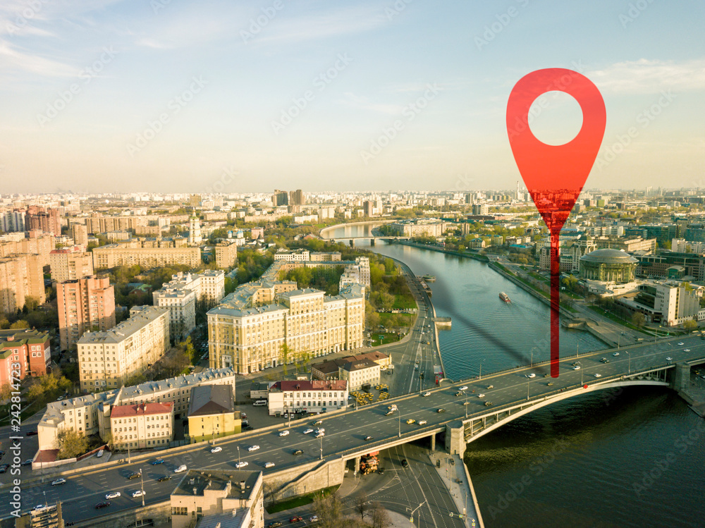 Fototapeta aerial shot of marker pointing on the streets of europe city during sunset b