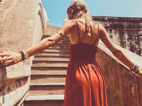fototapeta na lodówkę Beautiful attractive woman posing outdoors.