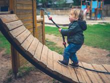 Little Toddler On Play Equipment In Park
