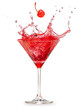 canvas print picture - cherry falling into a splashing red cocktail isolated on white