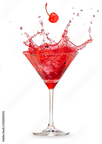 Tableau sur Toile cherry falling into a splashing red cocktail isolated on white