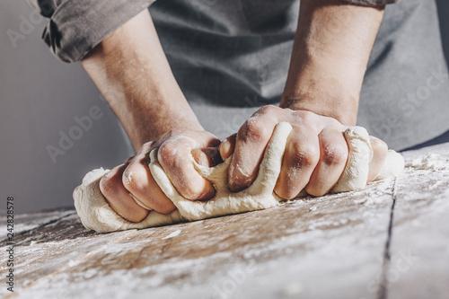 Fototapeta Chef making and kneading fresh dough
