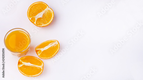 Fototapety, obrazy: Glass of orange juice and slices of orange fruit on white background. Flat lay. Copy space.