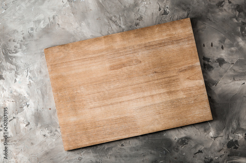 Vászonkép Wooden kitchen board on grey background