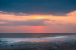 Sunset on Horizon Line Over Sea and Colorful Evening Sky. Turquoise Wave & Surfing Tube is Illuminated from the Middle. Hollow Wave, a Powerful Barreling Wave Breaking and Creating the Perfect Tube