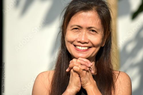 Fotografie, Obraz  Minority Female Senior Praying