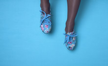 Sneakers With Floral Print On The Blue Background