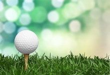 Golf Ball With A Golf Tee On