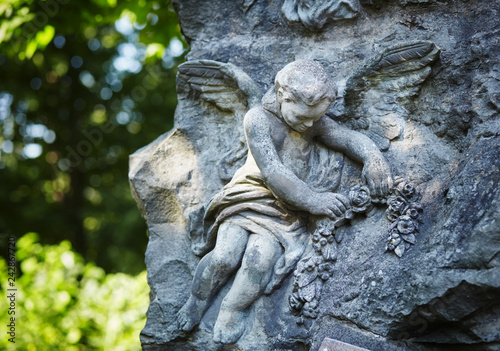 angel statue in sunlight as a symbol of strength, truth and faith Fototapete