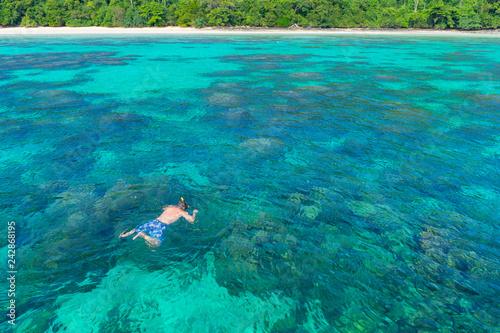 Fototapeta Traveler diving in the sea at Phuket, Thailand. obraz