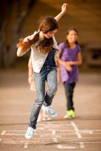 Girls Playing Hopscotch.
