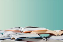 Heap Of Open Books At School Room Background