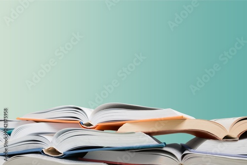 Stampa su Tela Heap of open books at school room background