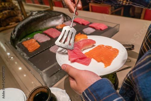 Fotografie, Obraz  Choosing delicious Salmon Sashimi on the white plate