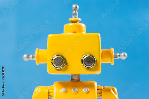 Photo  Portrait of a Cute, yellow, handmade robot.