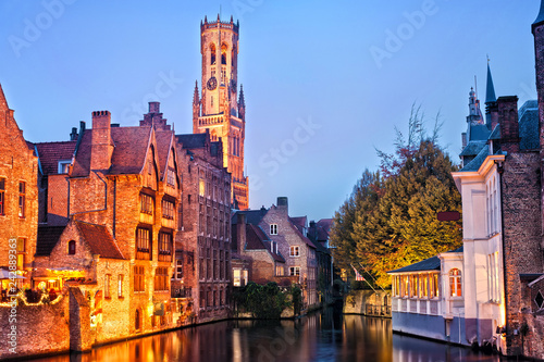 Foto auf Gartenposter Kunstdenkmal View of river canal and Belfort (Belfry) tower at twilight from Rozenhoedkaai,famous boat tour point in Bruges, Belgium.