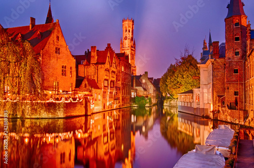 Poster Artistique View of river canal and Belfort (Belfry) tower at twilight from Rozenhoedkaai,famous boat tour point in Bruges, Belgium.