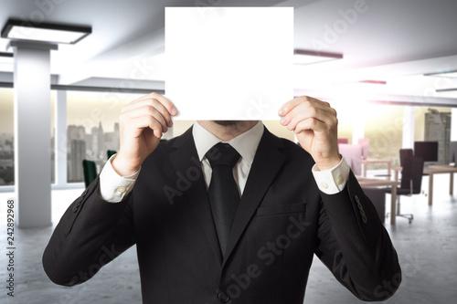 Fotografia  businessman in modern office hides face behind sign 3D Illustration