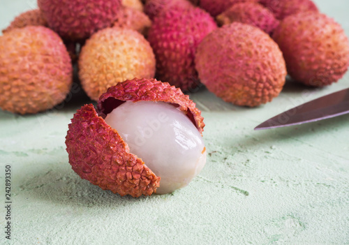 Ripe lychees on a green table.