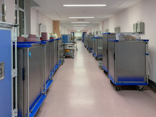 In A Long Hallway In A Modern Hospital Food Trolleys Are Ready. Concept: Health And Diet
