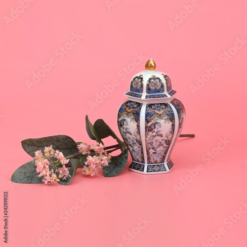 Fotografie, Obraz  Classic oriental vase with jasmine branch isolated on pink (coral) background