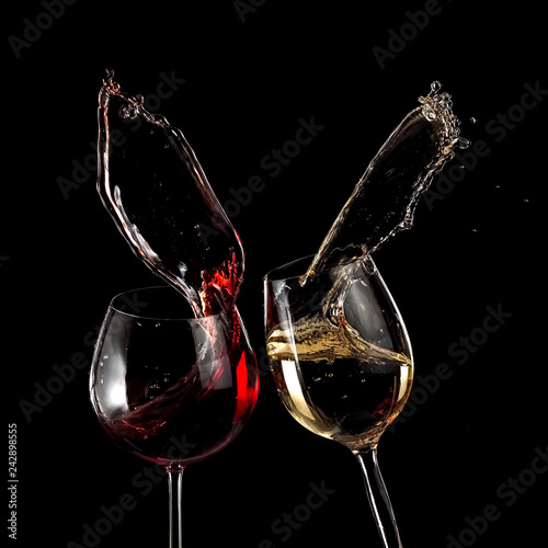Obraz na plátně  Red and white wine glasses up on black background