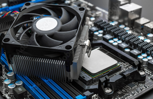 Obraz Fan for processor on motherboard. Close up. - fototapety do salonu