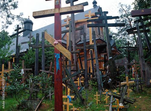 Obraz Grabarka, Orthodox crosses brought by pilgrims to the Holy Mount of Grabarka. Podlaskie Voivodeship. Polish Orthodox pilgrimage center. - fototapety do salonu