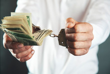 Man Hand Handcuffs With Money