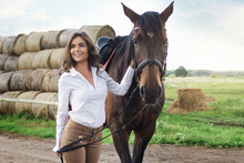 Young Woman Rider And Her Beautiful Horse